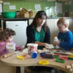 Children making and playing with flour and water